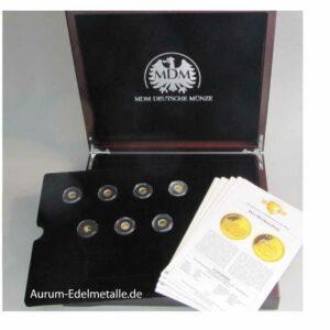 Die kleinsten Goldmünzen der Welt komplettes Set 14 x 0_5g mit Zertifikat in OVP Holzbox